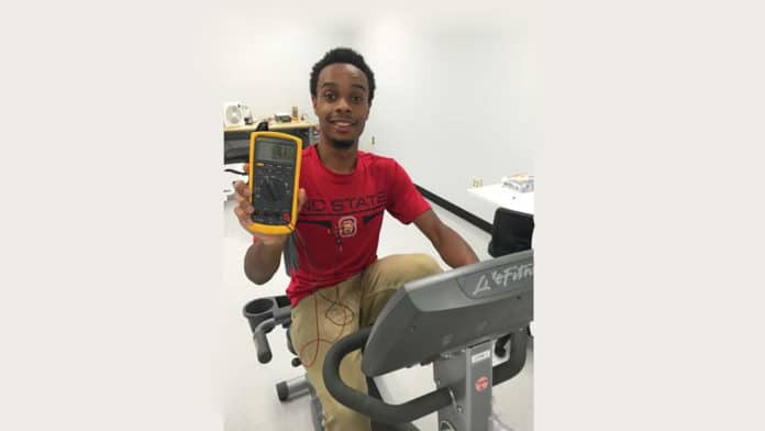Researchers have developed a new design for harvesting body heat and converting it into electricity for use in wearable electronics. The tech can be embedded in a T-shirt, as shown here on study co-lead Haywood Hunter, an undergraduate at NC State University.