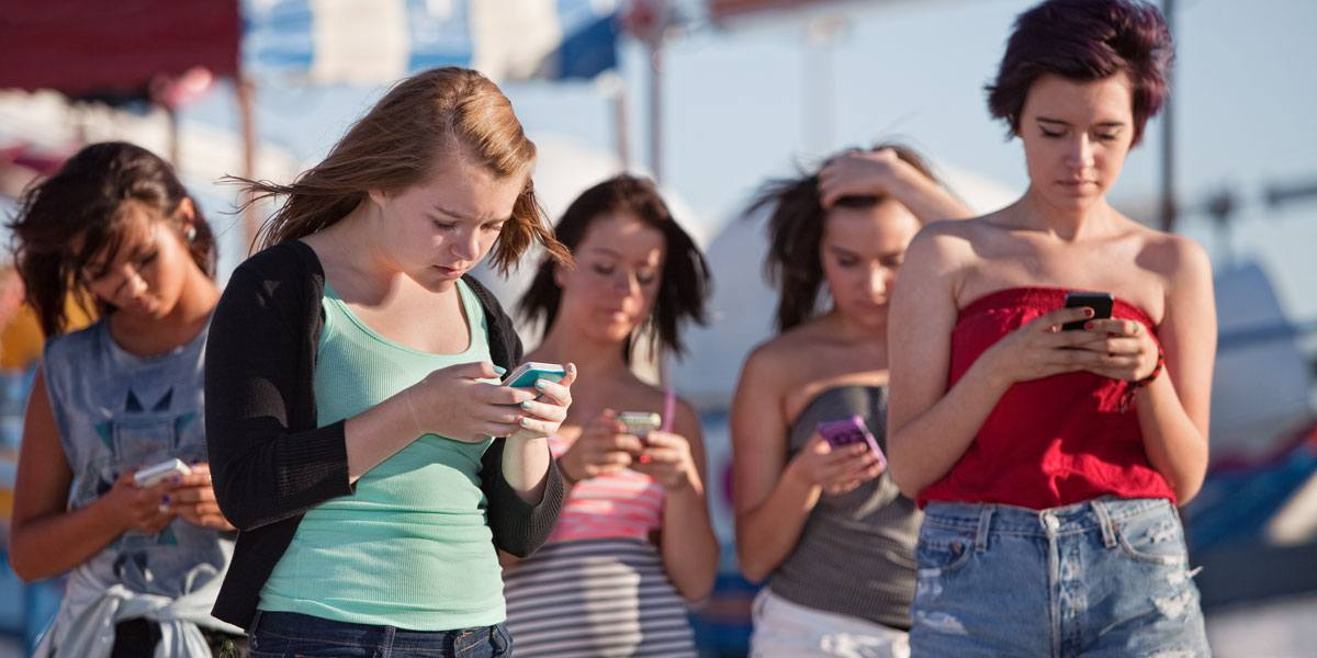 Image result for images of students addicted to the use of mobile telephone