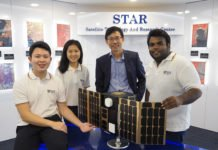 Professor Low Kay Soon (second from right), Director of the Satellite Technology and Research Centre at NUS, together with his students from NUS Engineering. On display is a model of a small satellite that is being developed for applications such as maritime and aviation security.