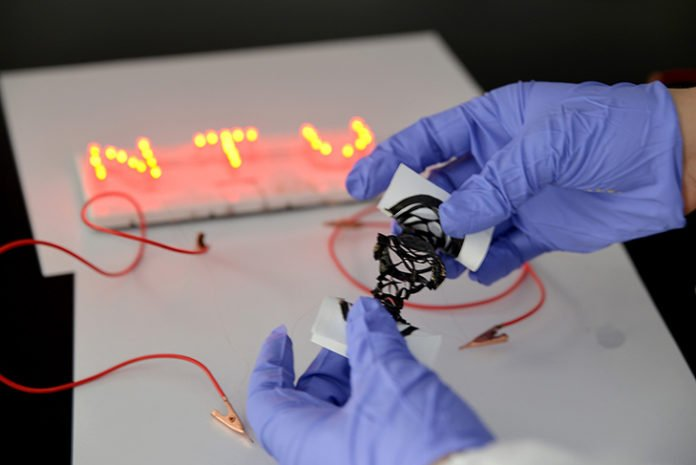 Researchers create customizable, fabric-like power source for wearable electronics
