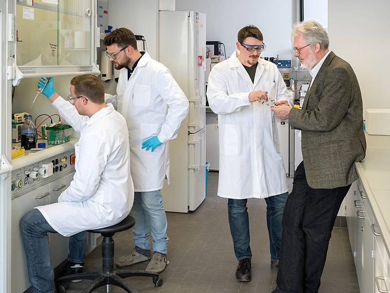 Coauthors Dr. Florian Reichart, Dr. Andreas Räder, Michael Weinmueller and Prof. Horst Kessler (fltr) in the laboratory
