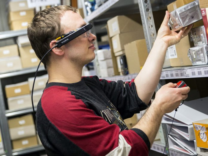 Marc Pulz uses the data glasses during logistics activities
