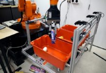 "The ""pick-and-place"" system consists of a standard industrial robotic arm that the researchers outfitted with a custom gripper and suction cup. They developed an ""object-agnostic"" grasping algorithm that enables the robot to assess a bin of random objects and determine the best way to grip or suction onto an item amid the clutter, without having to know anything about the object before picking it up."
