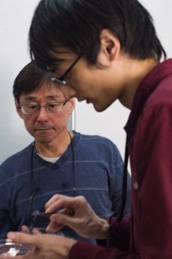 Rice University researchers Junichiro Kono, left, and Fumiya Katsutani prepare a nanotube film for testing. The lab observed a novel quantum effect in their carbon nanotube film that could lead to the development of near-infrared lasers and other optoelectronic devices. Photo by Jeff Fitlow
