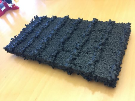 A 3-D-printed model of a peptoid nanosheet, showing patterned rows of sugars. (Credit: Berkeley Lab)