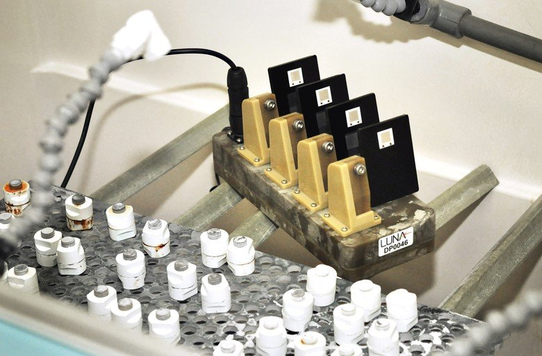 In conjunction with Luna, Inc. and engineers at the Air Force Corrosion Prevention and Control Office, researchers at the Air Force Research Laboratory have developed a new corrosion and coating evaluation system, CorRES, that can measure the ability of coatings to protect aircraft structures by using sensor panels that measure localized changes during corrosion testing. Unlike conventional coating tests that rely on an expert's visual evaluation of a test panel at the conclusion of a test cycle, the CorRES takes measurements throughout a coating's test and transmits data in real-time to a base station for evaluation. Ultimately, the test will reduce costs associated with coating materials development and implementation through better data and understanding. (Courtesy photo)