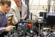 Dr Chris Ballance and Vera Schäfer with ion-trap apparatus in one of Oxford's quantum technology laboratories. Image credit: David Fisher / NQIT