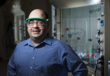 Javier Vela and the chemists in his research group have been working to produce semiconductors from materials that are safe, abundant and inexpensive to manufacture. Larger photo. Photo by Christopher Gannon and courtesy of the College of Liberal Arts and Sciences.