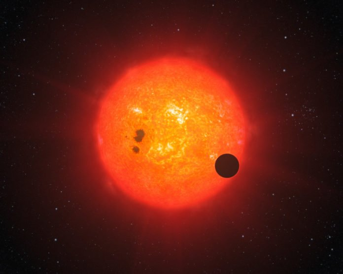 This artist's impression shows how the newly discovered super-Earth surrounding the nearby star GJ1214 may look. Discovered by the MEarth project and investigated further by the HARPS spectrograph on ESO's 3.6-metre telescope at La Silla, GJ1214b is the second super-Earth exoplanet for which astronomers have determined the mass and radius, giving vital clues about its structure. It is also the first super-Earth around which an atmosphere has been found. The exoplanet, orbiting a small star only 40 light-years away from us, thus opens dramatic new perspectives in the quest for habitable worlds. The planet, GJ1214b, has a mass about six times that of Earth and its interior is likely mostly made of water ice. It appears to be rather hot and surrounded by a thick atmosphere, which makes it inhospitable for life as we know it on Earth.