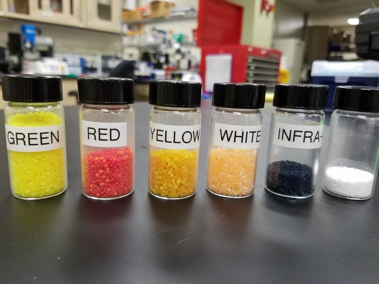 "AFRL-developed microencapsulated chemiluminescent materials were recently licensed to Battle Sight Technologies LLC for the production of glowing ""crayons"" that can be created in many colors for different uses. (U.S. Air Force Photo/Holly Jordan)"
