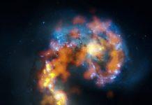 Distribution of gaz in two interacting galaxies. Picture combining optical (Hubble) and radio (ALMA) data. ©NRAO/ALMA/NASA/ESA/B.Saxton.