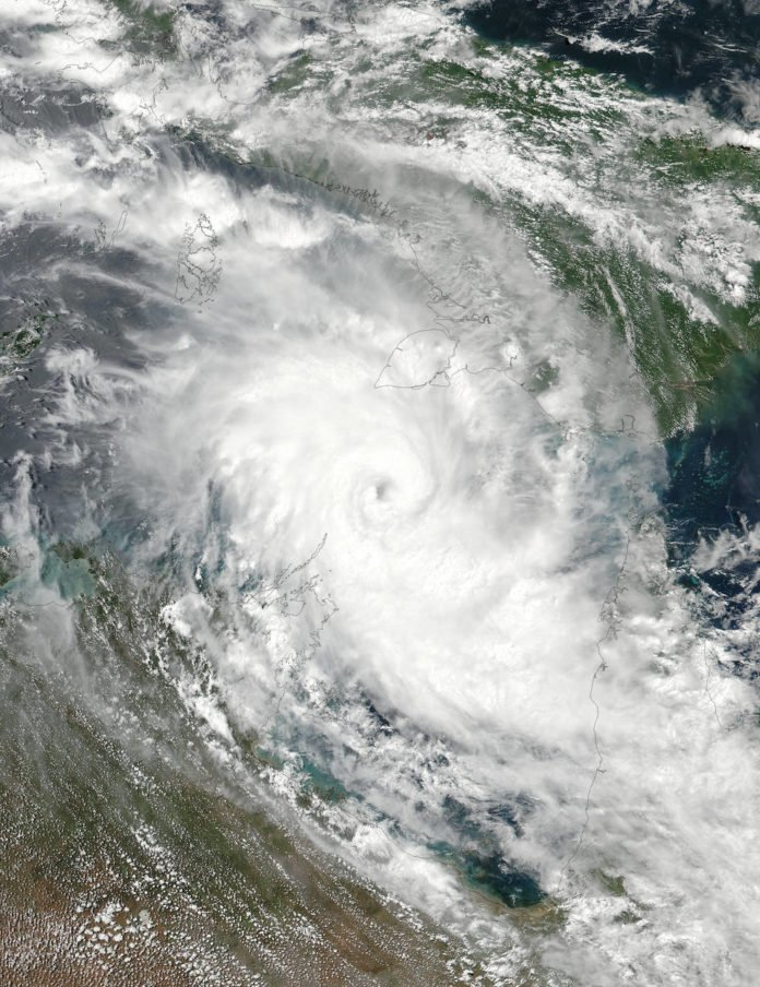 On March 23 at 12:36 a.m. EDT (0436 UTC) a visible image of Tropical Storm Nora was acquired from the VIIRS instrument aboard NASA-NOAA's Suomi NPP satellite as it continued moving between northern Australia and New Guinea. Credits: NOAA/NASA Rapid Response Team