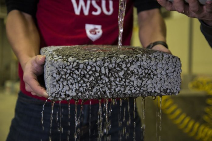 Water runs through Washington State University pervious pavement. Credit: Washington State University