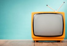 A vintage orange TV