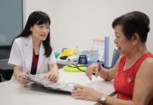 Associate Professor Joyce Lee with Madam Poh Kim Choo, who has type 2 diabetes. Madam Poh's HbA1c (average blood sugar) improved within four months of participation in the pharmacist-managed diabetes service. Credit: National University of Singapore