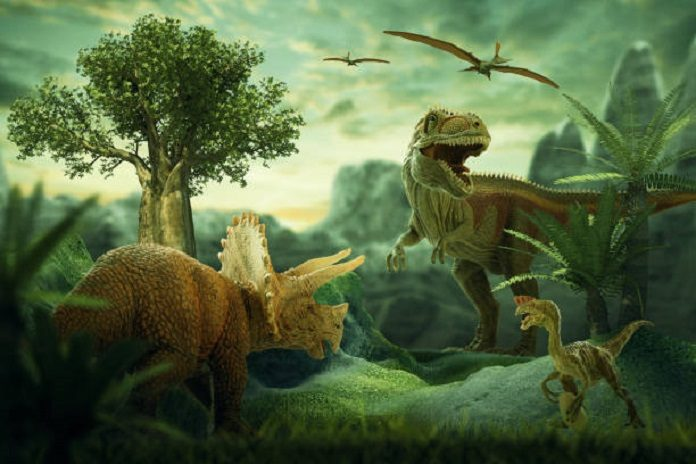 A life-scene from 232 million years ago, during the Carnian Pluvial Episode after which dinosaurs took over. A large rauisuchian lurks in the background, while two species of dinosaurs stand in the foreground. Based on data from the Ischigualasto Formation in Argentina. © Davide Bonadonna.