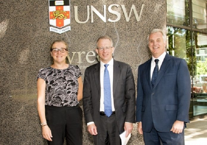 UNSW Associate Professor and Chair of the Australian Photovoltaics Institute, Renate Egan, Federal Minister for Urban Infrastructure and Cities, Paul Fletcher and UNSW's Dean of Engineering Professor, Mark Hoffman. Photo: Robert Largent