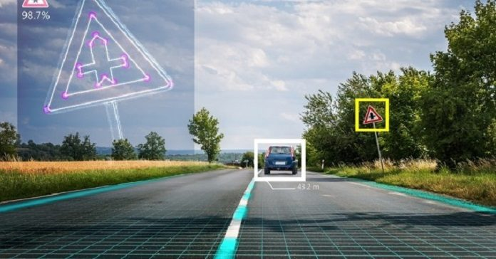 Autonomous self-driving car is recognizing road signs. Computer vision and artificial intelligence concept.