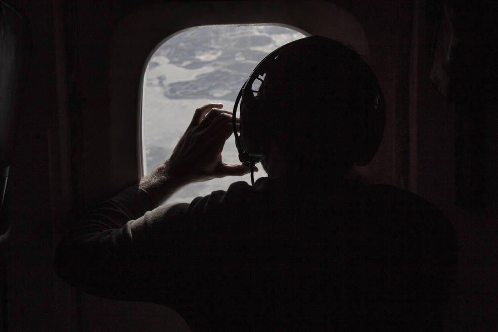 Researcher photographing the sea ice as the DC-8 flies over the Arctic January 2017. Credits: NASA/ Sam Hall
