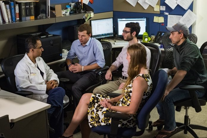 Rice University computational and applied mathematics students worked with Texas Medical Center doctors to develop a technique that simplifies the placement of electrodes in the brains of patients with epilepsy.From left, Dr. Nitin Tandon of UTHealth and Memorial Hermann-Texas Medical Center,Rice seniors Alex Gardner, Evan Toler, Wendy Knight and Rice alumnus Kiefer Forseth, a researcher at UTHealth. (Credit: Jeff Fitlow/Rice University)