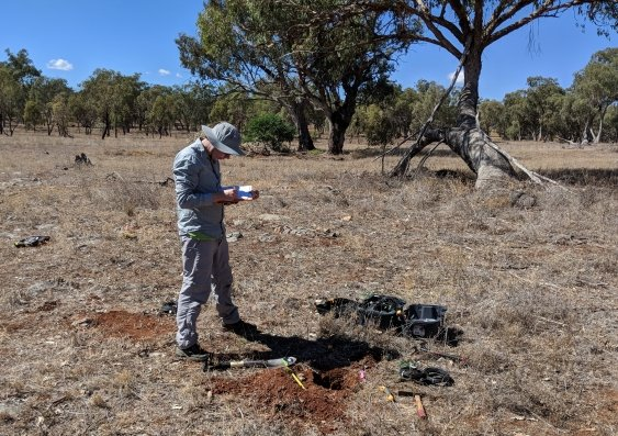 A scientists conducts research on soil moisture at Wellington Caves in NSW