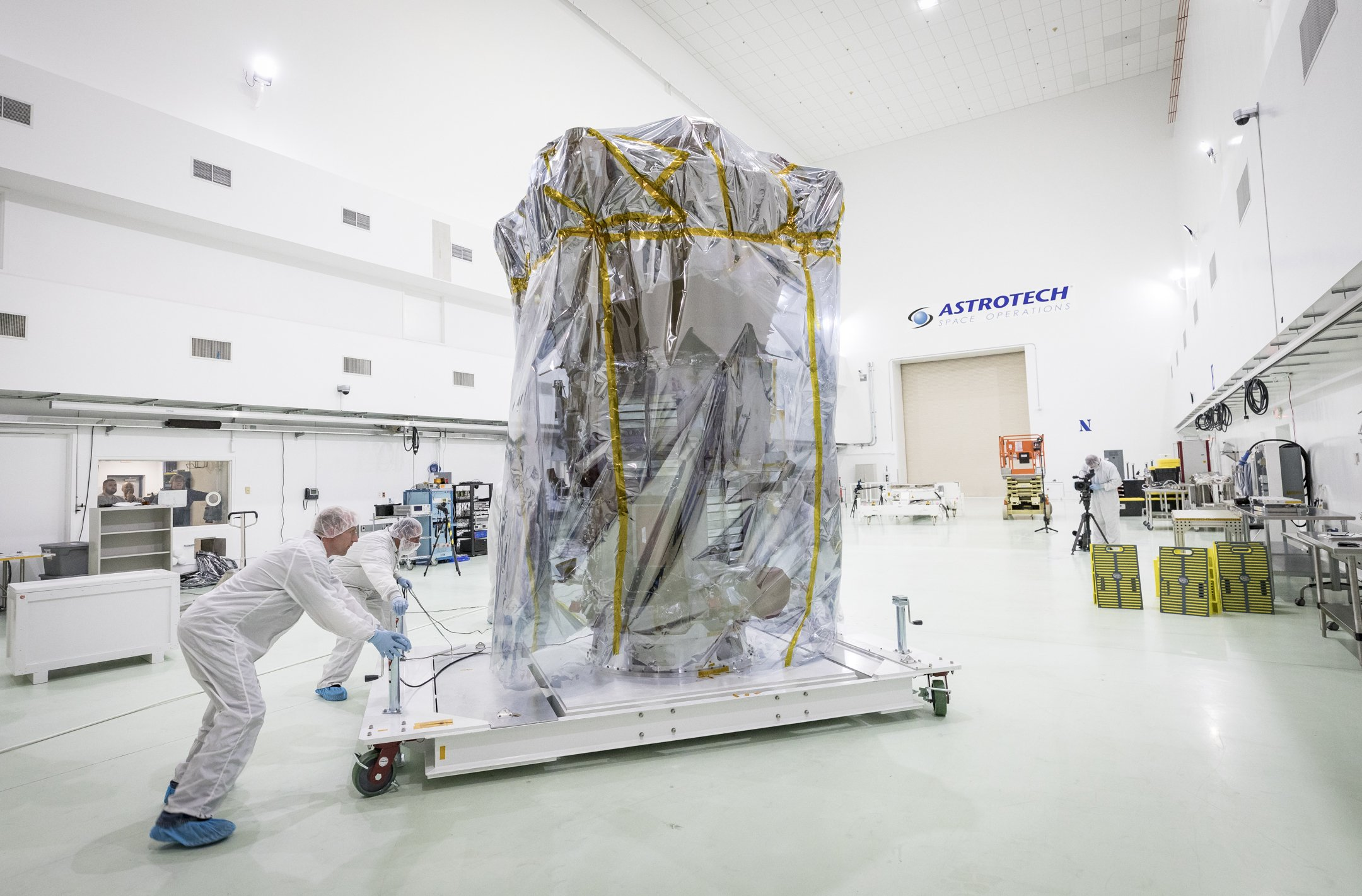 NASA's Parker Solar Probe is wheeled into position in a clean room at Astrotech Space Operations. Credits: NASA/Johns Hopkins APL/Ed Whitman