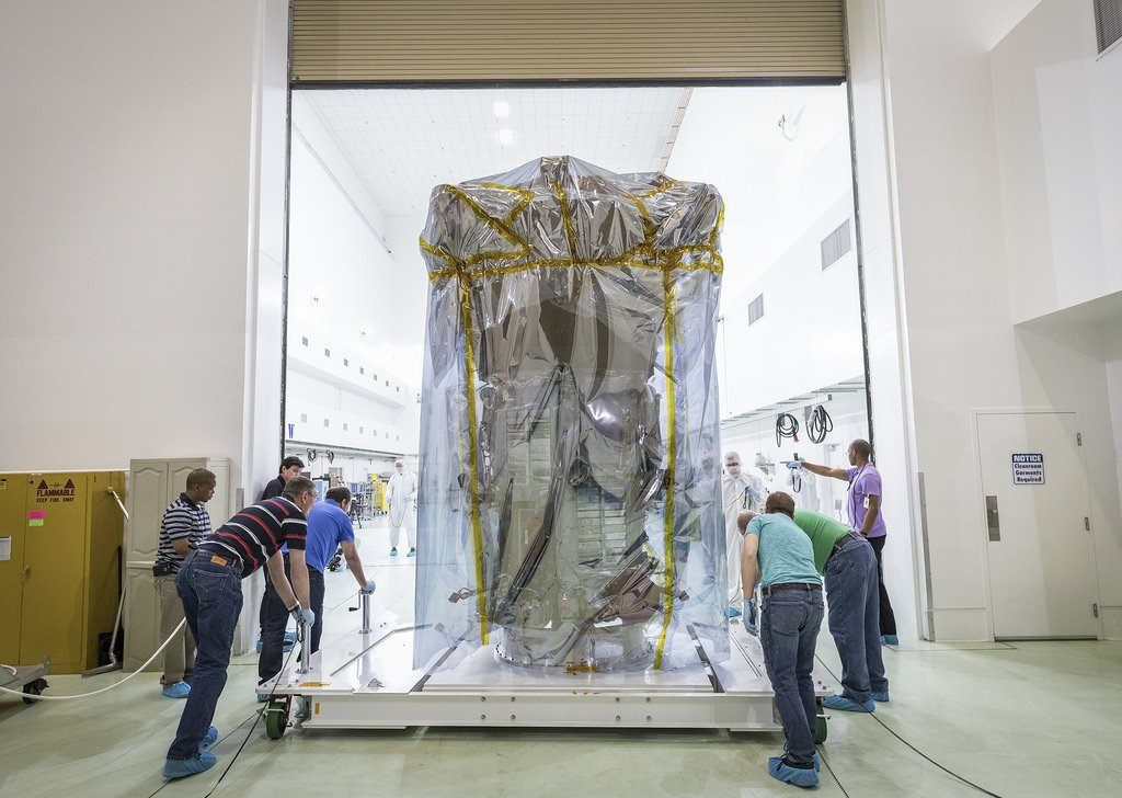 Protected by special plastic sheeting, NASA's Parker Solar Probe is wheeled into a clean room at Astrotech Space Operations in Titusville, Florida, for pre-launch testing and preparations. On April 3, 2018, the spacecraft was transported from NASA's Goddard Space Flight Center in Greenbelt, Maryland, to Joint Base Andrews by truck, then by a United States Air Force C-17 to Titusville.    Credit: NASA/Johns Hopkins APL/Ed Whitman