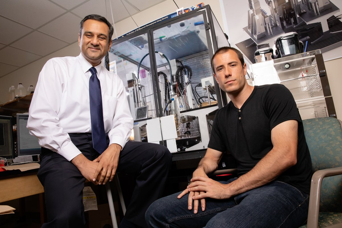 Illinois professor Rohit Bhargava, left, and Ph.D. graduate Matthew Gelber developed a free-form 3-D printer that can create scaffoldings out of sugar for tissue engineering and manufacturing applications.  Photo by L. Brian Stauffer