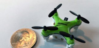 A new computer chip, smaller than a U.S. dime and shown here with a quarter for scale, helps miniature drones navigate in flight. Image courtesy of the researchers.
