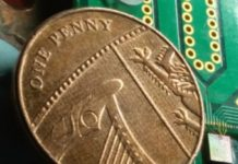 Chip containing all the optical components used to generate quantum-based random numbers at high speed. Here the chip, at the bottom-right corner of the picture, is placed next to a penny coin for comparison. Francesco Raffaelli, University of Bristol