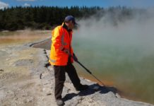 University of Canterbury microbiologist Dr Matthew Stott takes a sample at the Champagne Pool in the Waiotapu geothermal area of the North Island of New Zealand.