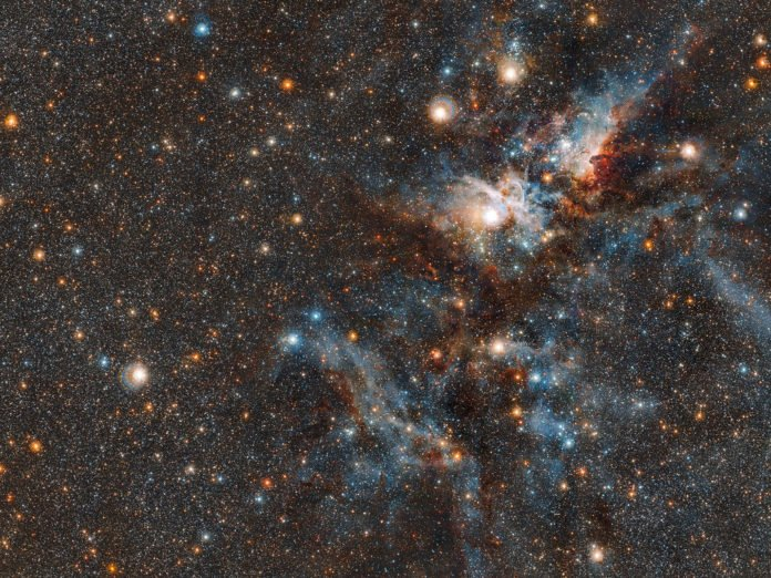 This wider coverage area reveals even more stars from the crowded neighbourhood surrounding the Carina nebula. Captured by VISTA, the world's largest infrared survey telescope, we witness the dramatic evolution of this living stellar city, where stars form and perish side by side.