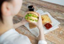 Women having junk food, tackling weight gain