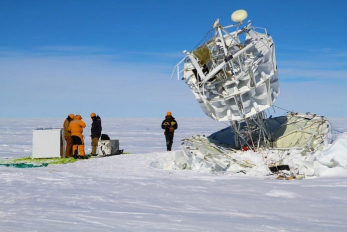 A team recovers NASA's Antarctic Impulsive Transient Antenna (ANITA) after a successful flight. Credit: Australian Antarctic Division