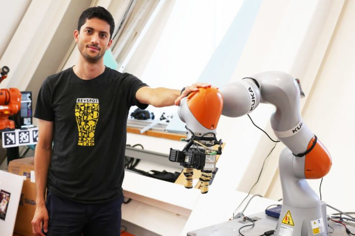 PhD student Lucas Manuelli worked with lead author Pete Florence to develop a system that uses advanced computer vision to enable a Kuka robot to pick up virtually any object.