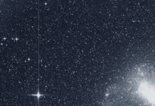 "The Transiting Exoplanet Survey Satellite (TESS) took this snapshot of the Large Magellanic Cloud (right) and the bright star R Doradus (left) with just a single detector of one of its cameras on Tuesday, Aug. 7. The frame is part of a swath of the southern sky TESS captured in its ""first light"" science image as part of its initial round of data collection. Credits: NASA/MIT/TESS"