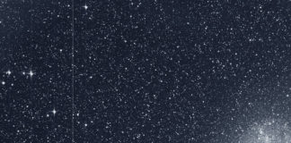 """The Transiting Exoplanet Survey Satellite (TESS) took this snapshot of the Large Magellanic Cloud (right) and the bright star R Doradus (left) with just a single detector of one of its cameras on Tuesday, Aug. 7. The frame is part of a swath of the southern sky TESS captured in its """"first light"""" science image as part of its initial round of data collection. Credits: NASA/MIT/TESS"""
