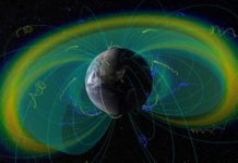 An artist's depiction of the Van Allen Belts, showing Earth's magnetic field lines and the trajectories of charged particles trapped by them. The twin ELFIN spacecraft are shown following their inclined polar orbit, traced in yellow. Credits: UCLA EPSS/NASA SVS