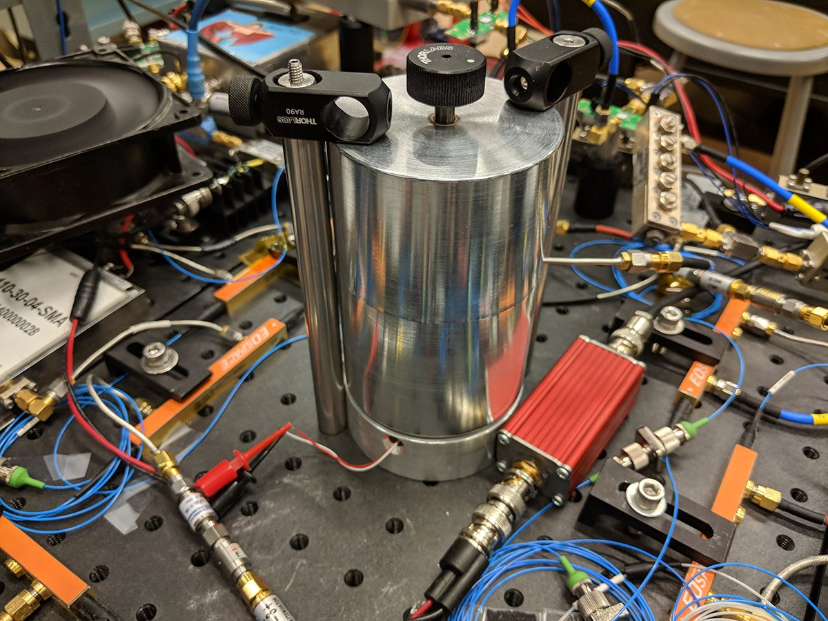 "NIST's ultrafast electro-optic laser relies on this aluminum ""can"" to stabilize and filter the electronic signals, which bounce back and forth inside until fixed waves emerge at the strongest frequencies and block or filter out other frequencies. Credit: D. Carlson/NIST"