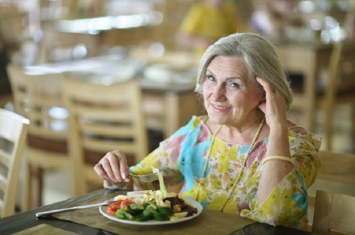 Portrait of beautiful elderly woman in cafe