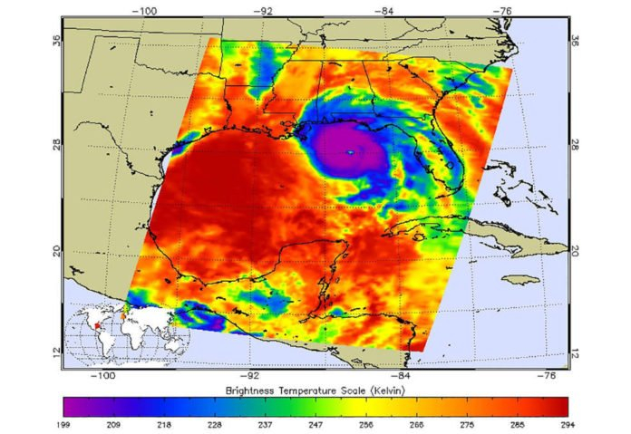 This AIRs image shows the temperature of clouds or the surface in and around Hurricane Michael. Purple represents very cold clouds, the much warmer eye is shown in green, and the red areas are warmer and mostly cloud-free. Credits: NASA/JPL-Caltech