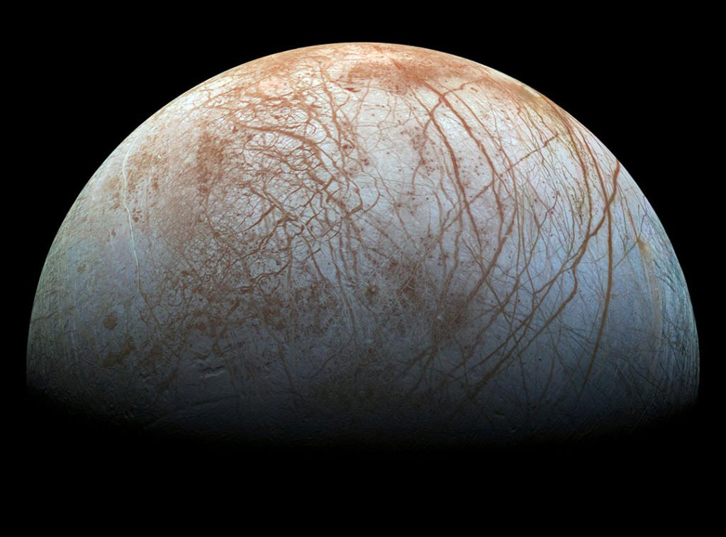Europa's icy surface is quite smooth overall, except for the numerous cracks which criss-cross the moon, making it look like a giant cracked egg.