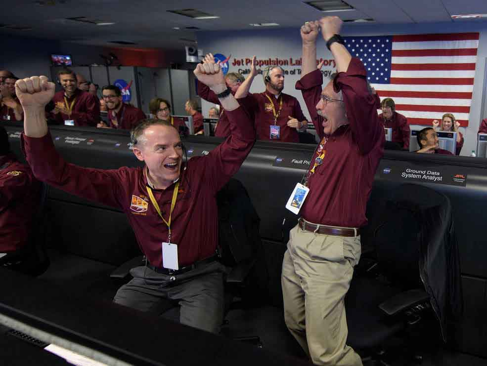 Mars InSight team members Kris Bruvold, left, and Sandy Krasner react after receiving confirmation that the Mars InSight lander successfully touched down on the surface of Mars, Monday, Nov. 26, 2018 inside the Mission Support Area at NASA's Jet Propulsion Laboratory in Pasadena, California. Credits: NASA/Bill Ingalls