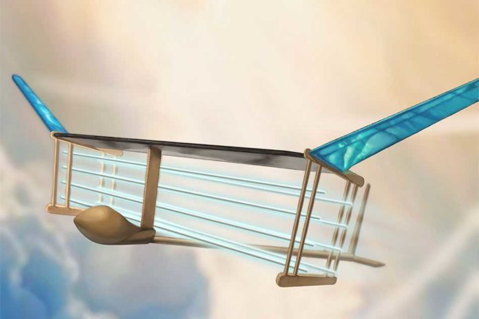 A new MIT plane is propelled via ionic wind. Batteries in the fuselage (tan compartment in front of plane) supply voltage to electrodes (blue/white horizontal lines) strung along the length of the plane, generating a wind of ions that propels the plane forward. Image: Christine Y. He