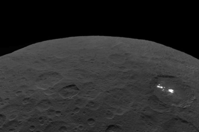 This photo of Ceres and the bright regions of Occator Crater was one of the last views NASA's Dawn spacecraft transmitted before it completed its mission. This view, which faces south, was captured on Sept. 1 at an altitude of 2,340 miles (3,370 kilometers) as the spacecraft was ascending in its elliptical orbit. Image Credit: NASA/JPL-Caltech/UCLA/MPS/DLR/IDA