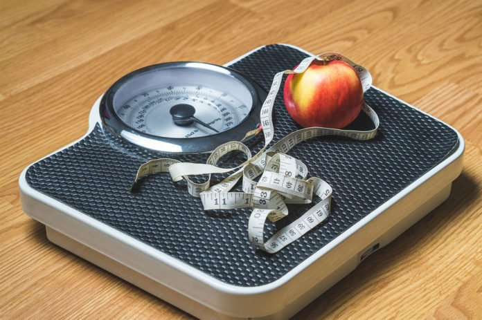 Daily weighing may be key to losing weight