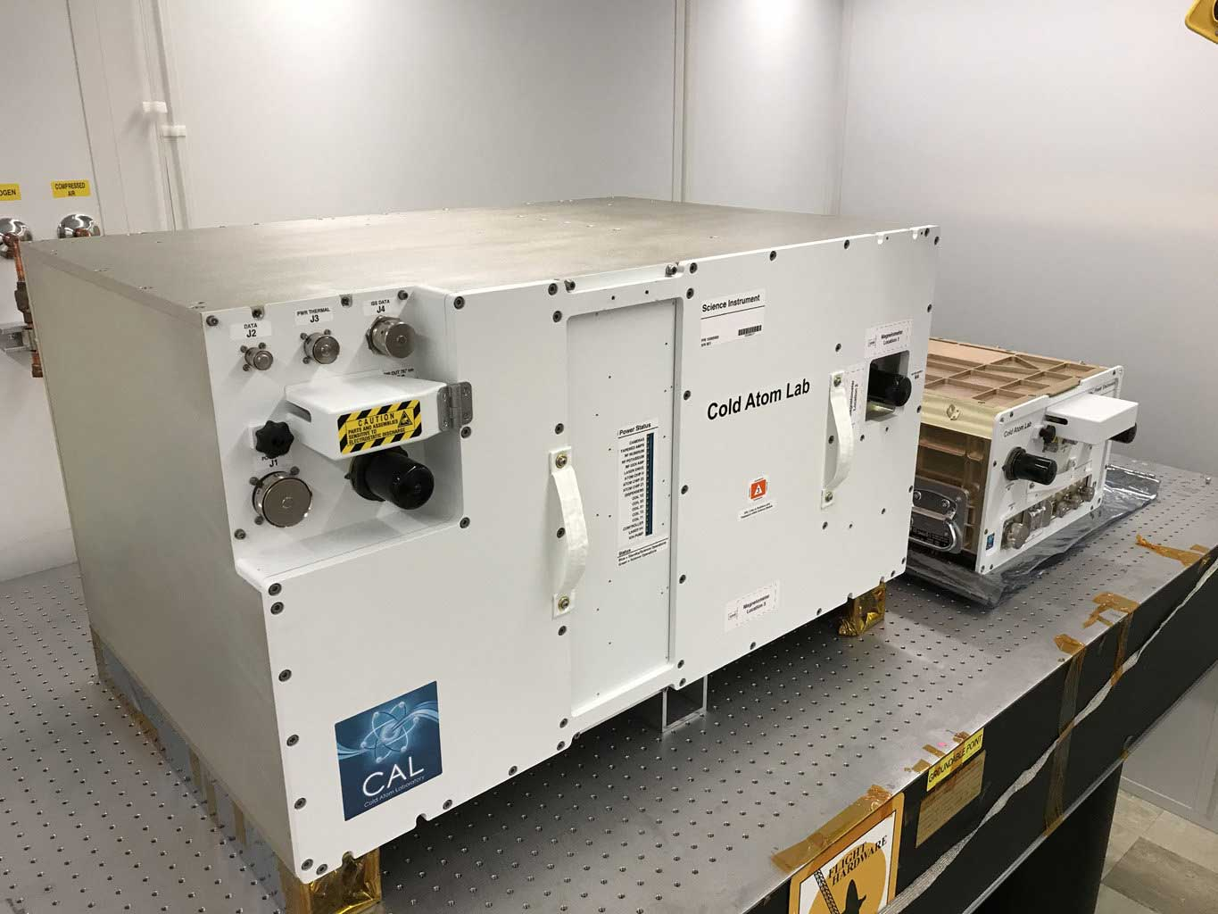 The Cold Atom Laboratory (CAL) consists of two standardized containers that will be installed on the International Space Station. The larger container holds CAL's physics package, or the compartment where CAL will produce clouds of ultracold atoms. Credit: NASA/JPL-Caltech