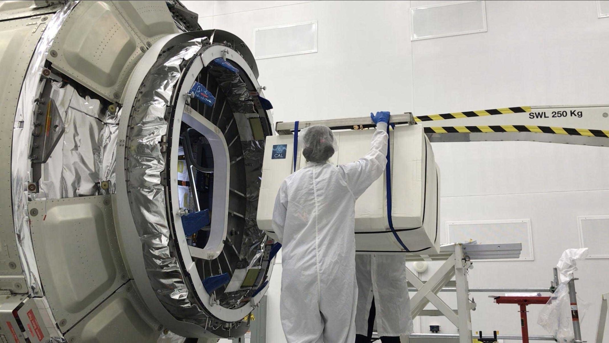 The Cold Atom Laboratory (CAL), packaged in a protective layer, is loaded onto a Northrop Grumman (formerly Orbital ATK) Cygnus spacecraft for its trip to the International Space Station. The facility launched in May 2018 from NASA's Wallops Flight Facility in Virginia. Credit: NASA/Northrop Grumman