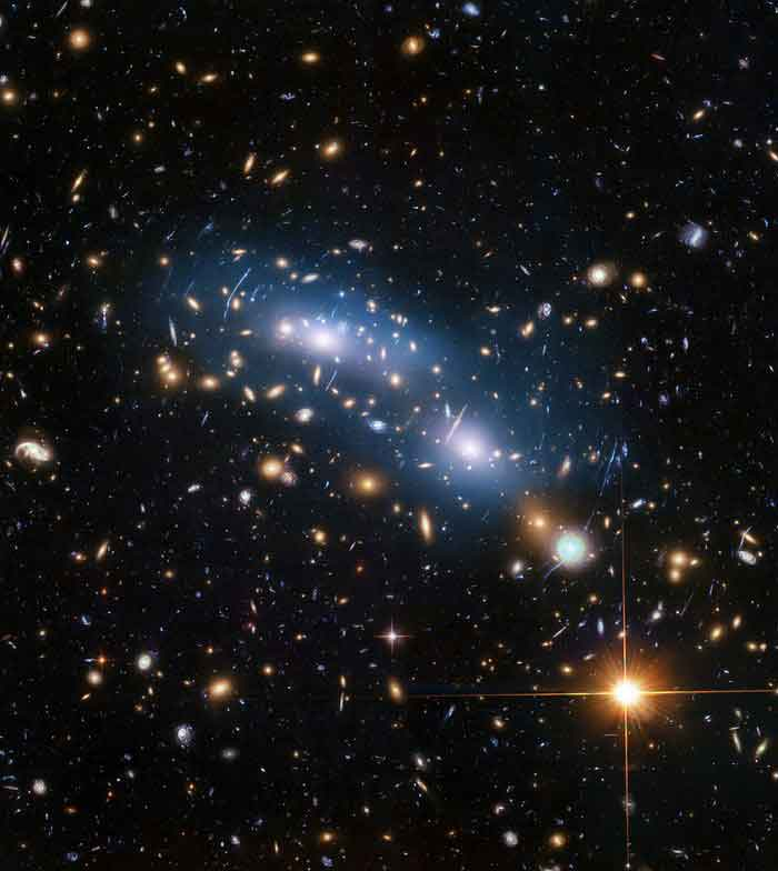 This image from the NASA/ESA Hubble Space Telescope shows the galaxy cluster MACS J0416. This is one of six being studied by the Hubble Frontier Fields programme, which together have produced the deepest images of gravitational lensing ever made.  Scientists used intracluster light (visible in blue) to study the distribution of dark matter within the cluster.  Credit: NASA, ESA, and M. Montes (University of New South Wales, Sydney, Australia)