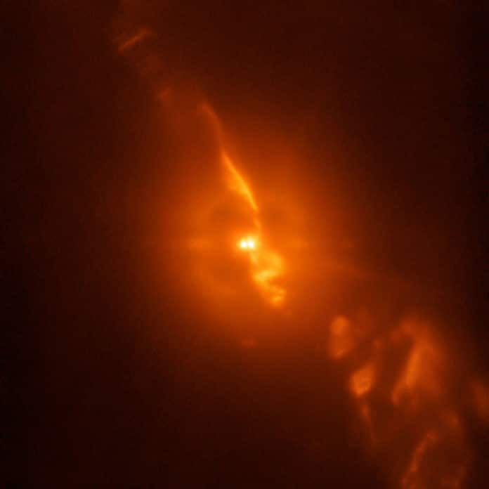 While testing a new subsystem on the SPHERE planet-hunting instrument on ESO's Very Large telescope, astronomers were able to capture dramatic details of the turbulent stellar relationship in the binary star R Aquarii with unprecedented clarity — even compared to observations from the NASA/ESA Hubble Space Telescope. This image is from the SPHERE/ZIMPOL observations of R Aquarii, and shows the binary star itself, as well as the jets of material spewing from the stellar couple. Credit: ESO/Schmid et al.